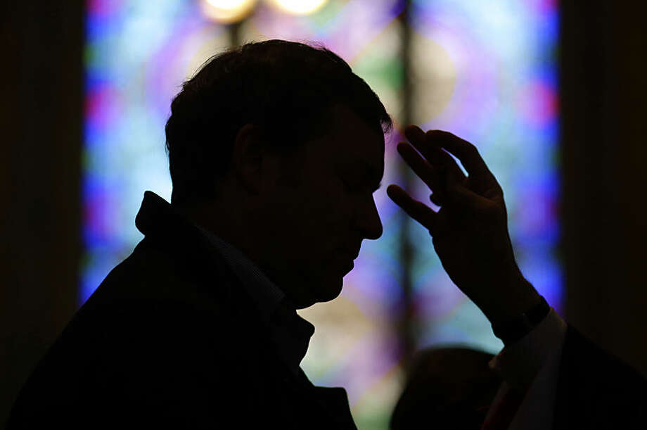 A man receives ashes from Baltimore Archbishop William Lori during an Ash Wednesday Mass, Wednesday, Feb. 18, 2015, in Baltimore. Ash Wednesday marks the start of the Lent, a season of prayer and fasting for Christians before Easter. (AP Photo/Patrick Semansky)