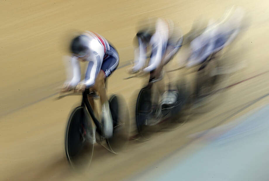 British team compete during the Women's team pursuit qualifying race at the Track Cycling World Championships in Saint Quentin-en-Yvelines, outside Paris, France, Wednesday, Feb. 18, 2015. (AP Photo/Christophe Ena)