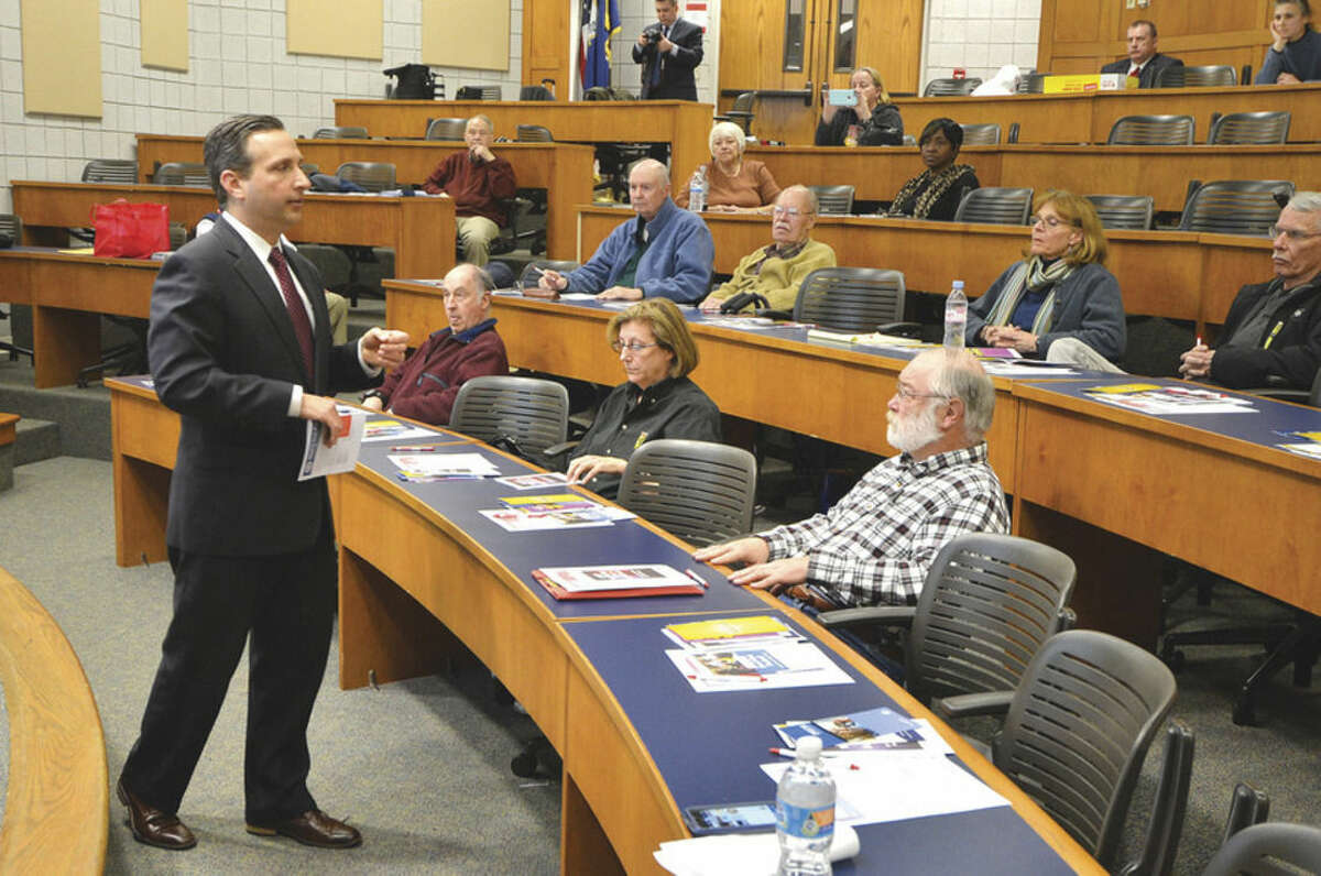 State Sen. Bob Duff talks at NCC during a program to help residents avoid fraud and scams.