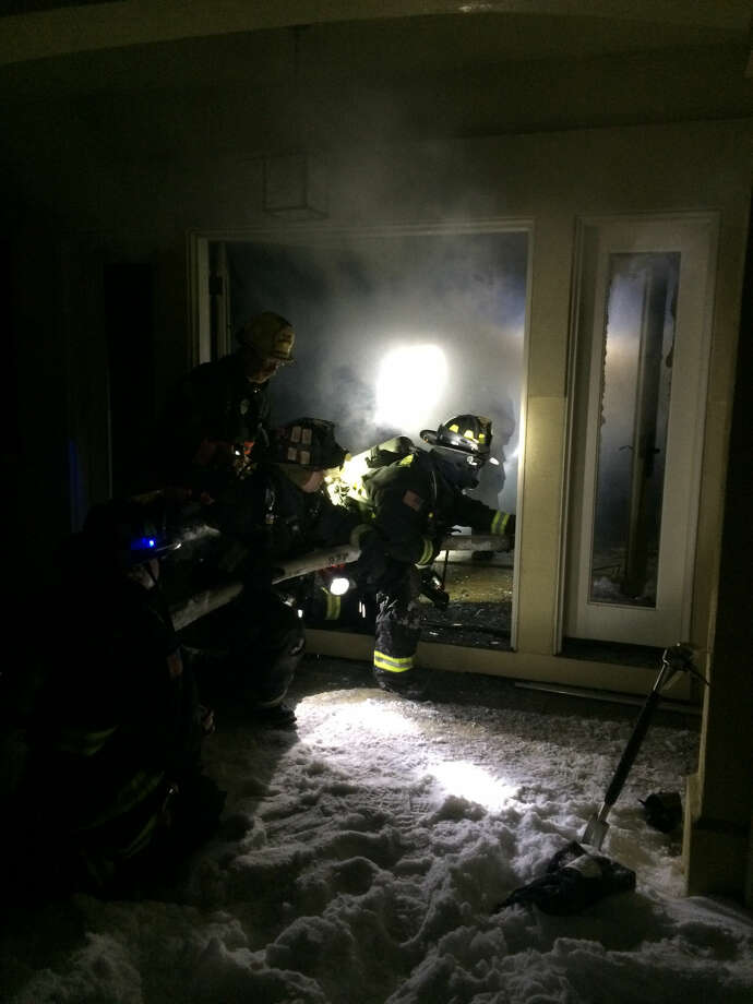 Contributed photoWestport firefighters fight a small blaze on Weathervane Hill Road Wednesday night.