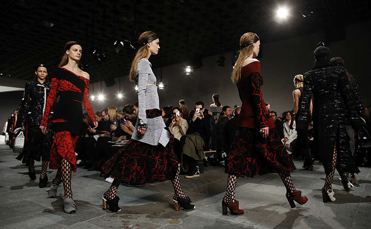 The Proenza Schouler Fall 2015 collection is modeled during Fashion Week, Wednesday, Feb. 18, 2015, in New York. (AP Photo/Jason DeCrow)