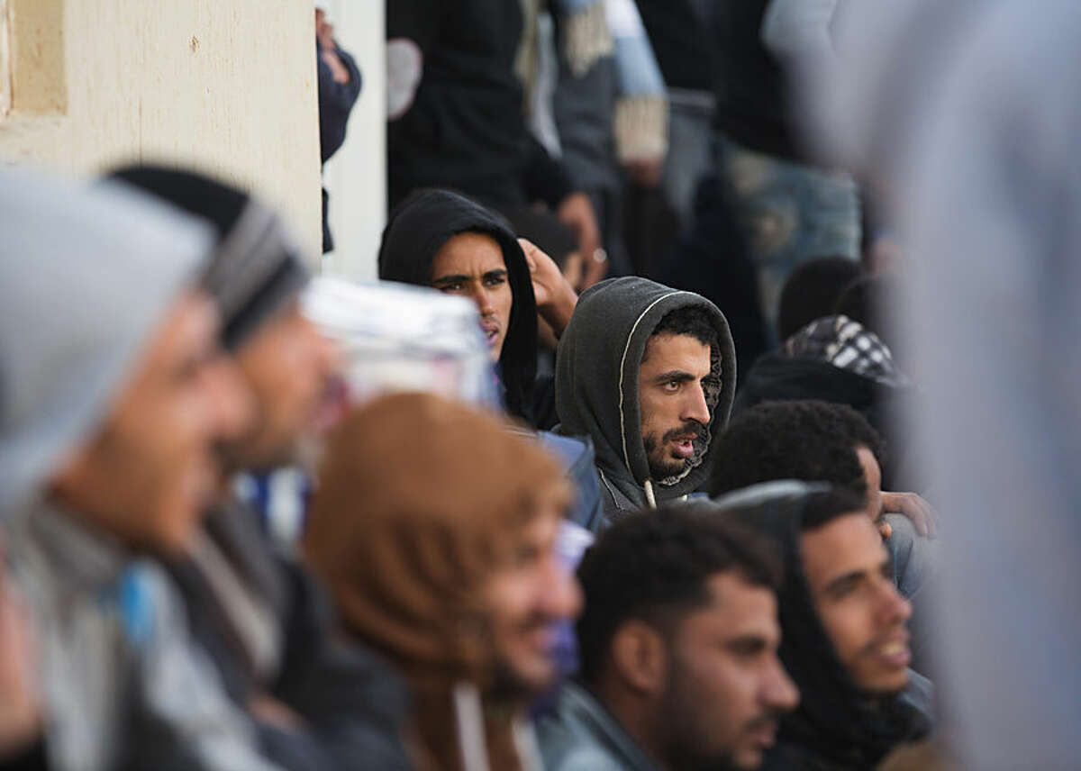 In this Wednesday, Feb. 18, 2015 photo, Egyptians wait to leave a detention center for illegal immigrants east of the city of Misrata, Libya during their deportation back to Egypt. The deportation follows the beheading of a group of Egyptian Christians by militants after they were abducted from Sirte, shown in a video that was produced by the Islamic State group media branch. (AP Photo/Mohamed Ben Khalifa)