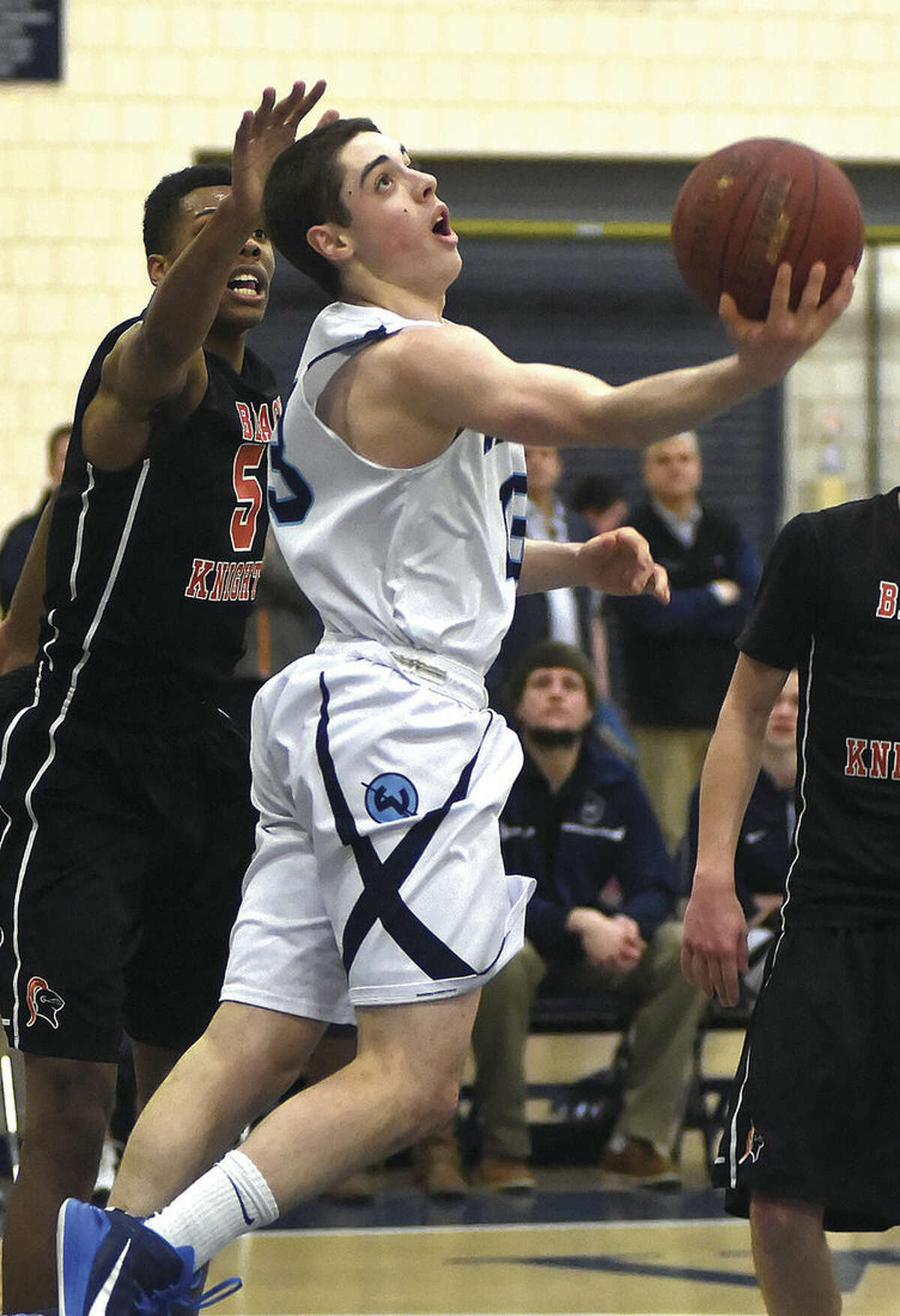 Hour photo/John Nash Wilton's Matt Shifrin, seen here in action against Stamford earlier this season, became the first Warriors boys basketball player to break the 1,000-point scoring barrier on Wednesday night.