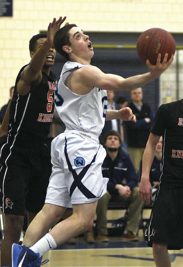 Hour photo/John NashWilton's Matt Shifrin, seen here in action against Stamford earlier this season, became the first Warriors boys basketball player to break the 1,000-point scoring barrier on Wednesday night.