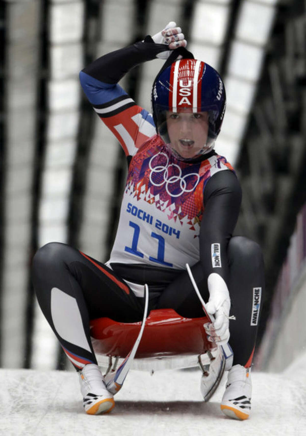 Erin Hamlin of the United States brakes in the finish area after finishing her first run during the women's singles luge competition at the 2014 Winter Olympics, Monday, Feb. 10, 2014, in Krasnaya Polyana, Russia. (AP Photo/Dita Alangkara)