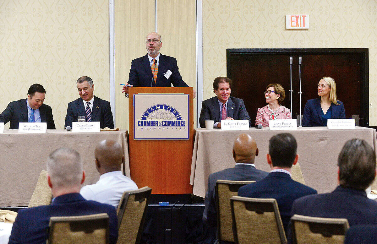 Hour photo / Erik Trautmann Moderator Harry Carey introduces the panelists during Stamford's legislative delegation annual breakfast Wednesday at the Stamford Sheraton Hotel. The annual breakfast is sponsored by the Stamford Chamber of Commerce.
