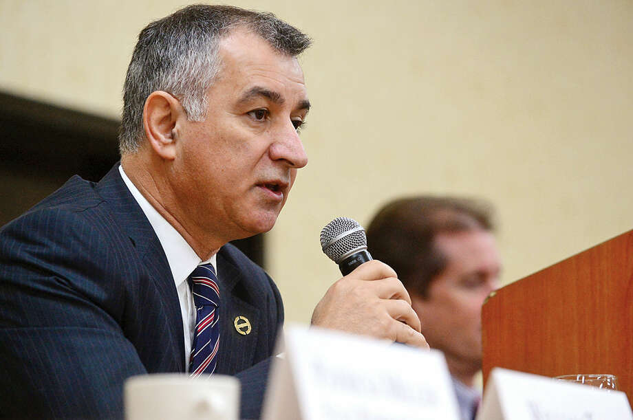 Hour photo / Erik Trautmann State Senator Carlo Leone discusses the current state of Connecticut during Stamford's legislative delegation annual breakfast Wednesday at the Stamford Sheraton Hotel. The annual breakfast is sponsored by the Stamford Chamber of Commerce.