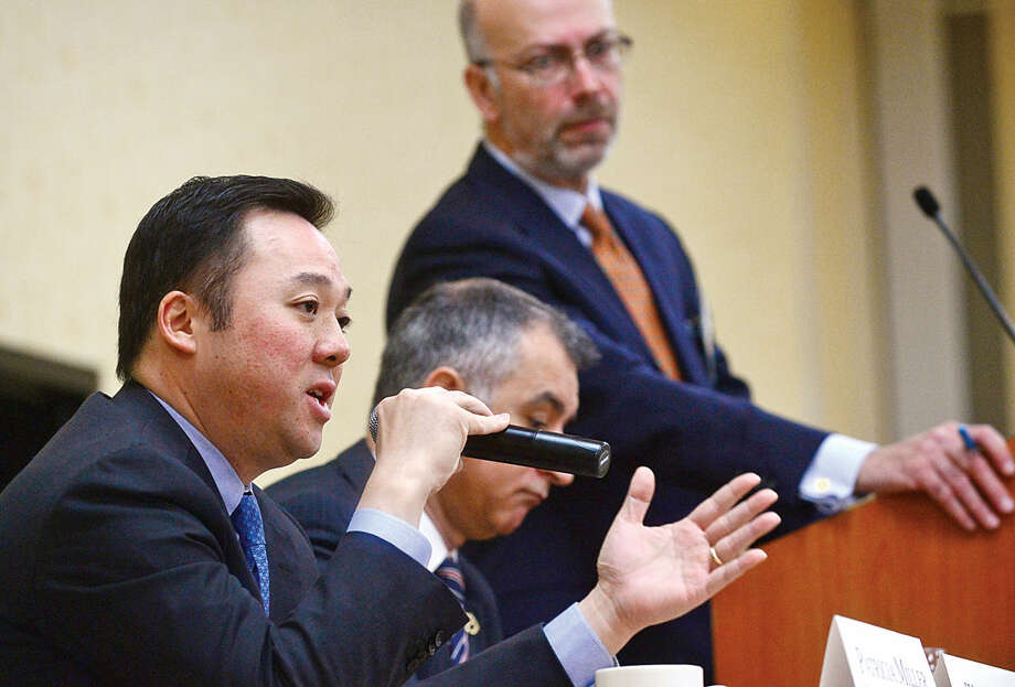 Hour photo / Erik Trautmann State Representative William Tong discusses the current state of Connecticut during Stamford's legislative delegation annual breakfast Wednesday at the Stamford Sheraton Hotel. The annual breakfast is sponsored by the Stamford Chamber of Commerce.