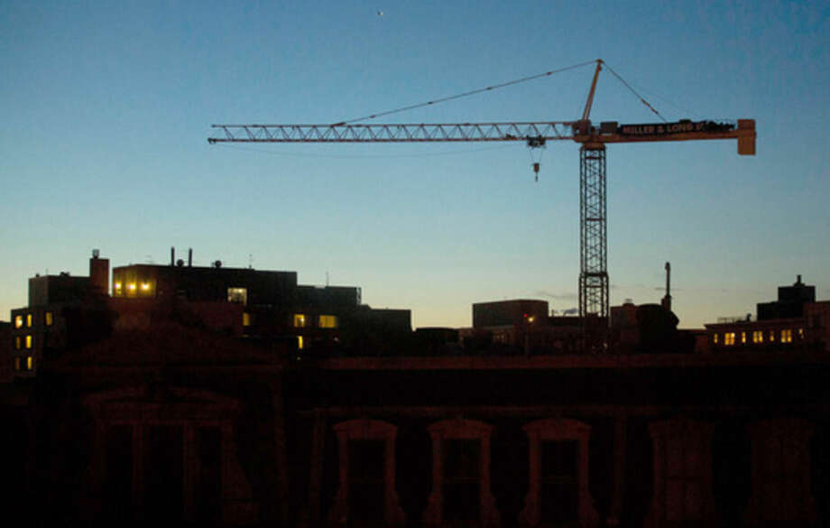 Bloomberg photo by Andrew HarrerA 2013 photo shows a crane over an apartment and retail construction site in Washington. Lenders are getting stingier when it comes to funding risky U.S. real estate developments, putting pressure on landlords in need of fresh funding to keep their projects afloat.