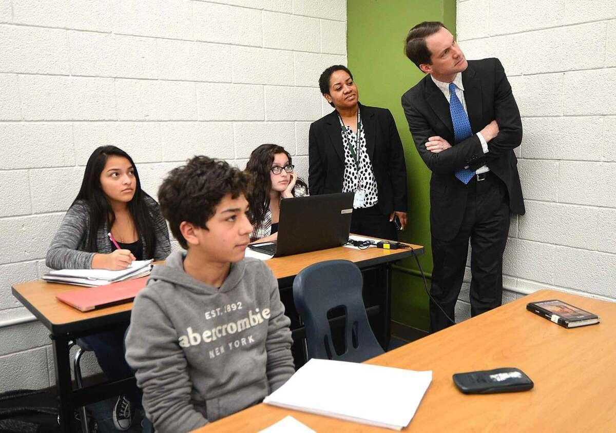 Hour Photo/Alex von Kleydorff PTech Director Karen Amaker shows Congressman Jim Himes some of the work being done in the P-Tech Classrooms at Norwalk High School