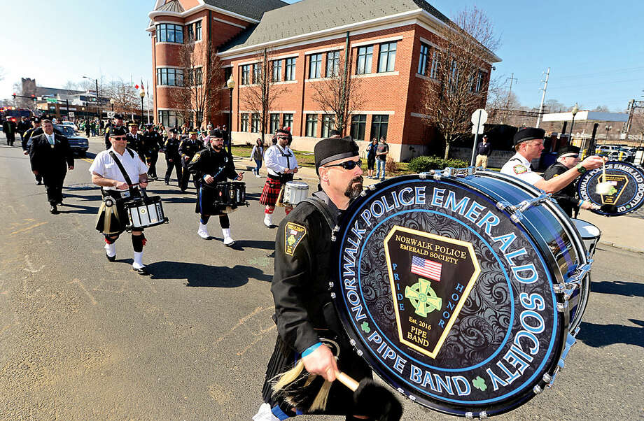 Hour photo / Erik Trautmann The Norwalk Police Emerald Society Pipe Band participates in the first Norwalk St. Patrick's Day parade Thursday which made it's way down South and North Main Streets ending at O'Neill's Pub.