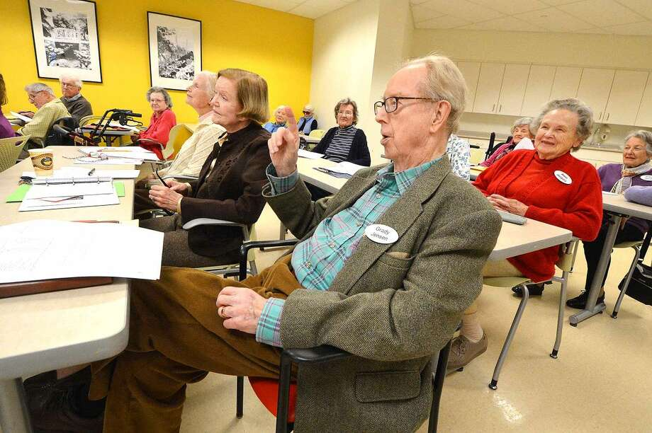 Hour Photo/Alex von Kleydorff Grady Jensen talks about his time with radio station KDKA in Pittsburgh Pa. as instructor Elliott Kalner asks a question about the patents of Thomas Edison during a history class taught by NCC at Meadow Ridge in Redding