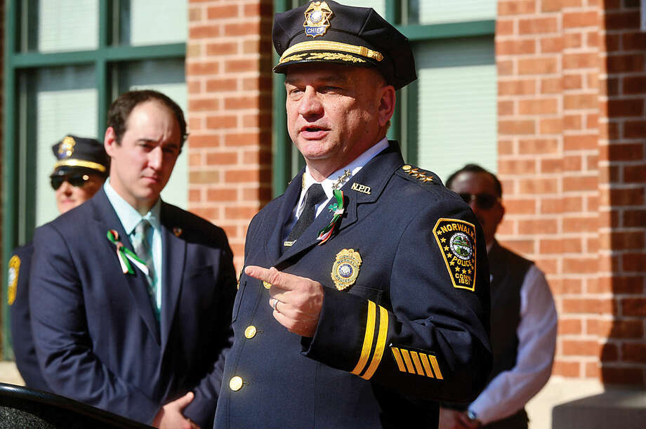 Hour photo / Erik Trautmann Norwalk Police Chief Thomas Kulhawik speaks during the Norwalk Police Department Emerald League ceremony in front of police headquarters before the first St. Patrick's Day parade Thursday.