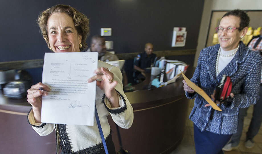 Sarah Goodfriend is overcome with joy as she shows off her wedding license certificate as she walks out the Travis County clerk's office with Suzanne Bryant on Thursday, Feb. 19, 2015 Austin, Texas. Travis County spokeswoman Ginny Ballard said the marriage occurred Thursday, though it wasn't immediately clear if the license has legal standing. The marriage followed a state District Court order instructing that officials not rely on Texas' unconstitutional prohibitions on same-sex marriage. (AP Photo/Austin American-Statesman, Ricardo B. Brazziell) AUSTIN CHRONICLE OUT, COMMUNITY IMPACT OUT; INTERNET AND TV MUST CREDIT PHOTOGRAPHER AND STATESMAN.COM; MAGS OUT