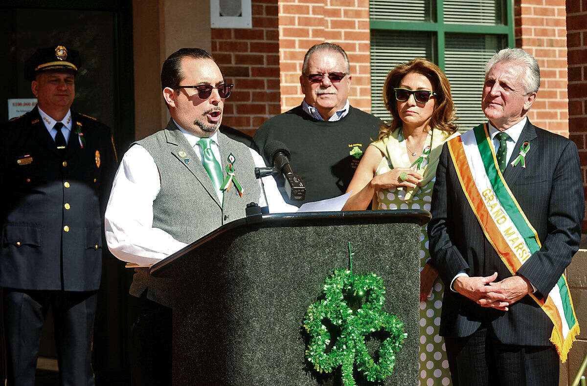 Hour photo / Erik Trautmann Matthew Surapine sings The Irish National Anthem as The Norwalk Police Department Emerald League holds a ceremony in front of police headquarters before the first St. Patrick's Day parade Thursday.