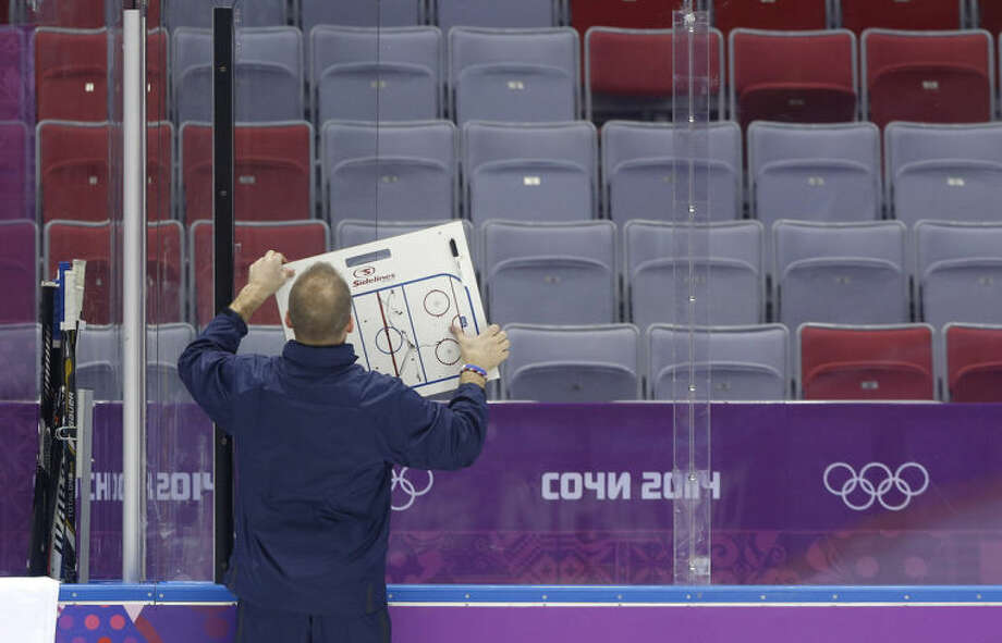 USA men's ice hockey coach Dan Bylsma posts up a diagram for the team during a training session at the 2014 Winter Olympics, Monday, Feb. 10, 2014, in Sochi, Russia. (AP Photo/Julie Jacobson)