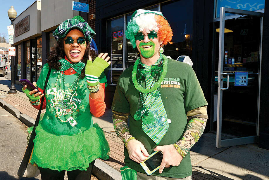 Hour photo / Erik Trautmann Norwalk residents including Judith Johnson and Mike Kelly cheer on the first Norwalk St. Patrick's Day parade Thursday which made it's way down South and North Main Streets ending at O'Neill's Pub.