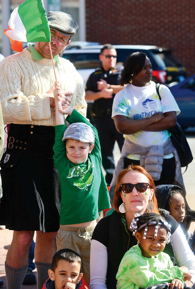 Hour photo / Erik Trautmann Columbus Magnet School kindergartners including Connor Morris listen to speeches during a ceremony before the first Norwalk St. Patrick's Day parade Thursday which made it's way down South and North Main Streets ending at O'Neill's Pub.