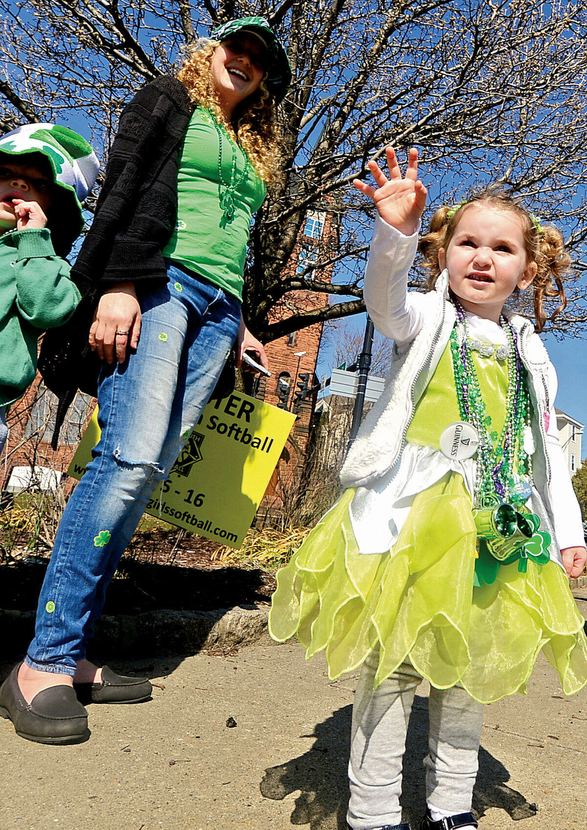 Hour photo / Erik Trautmann Norwalk residents including 2 year old Maya Cavell cheer on the first Norwalk St. Patrick's Day parade Thursday which made it's way down South and North Main Streets ending at O'Neill's Pub.