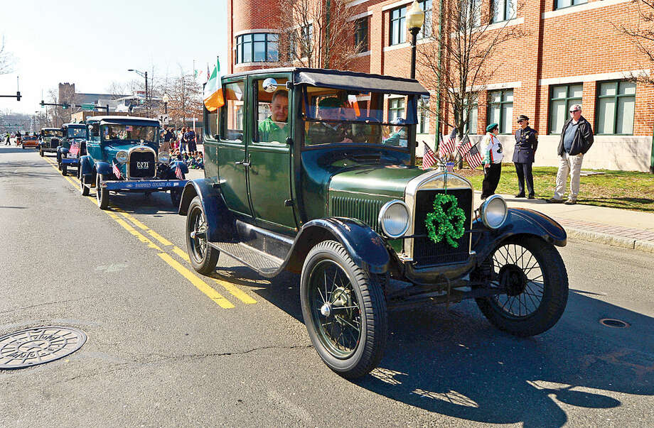 Hour photo / Erik Trautmann A lone of antique automoblies participate in the first Norwalk St. Patrick's Day parade Thursday which made it's way down South and North Main Streets ending at O'Neill's Pub.