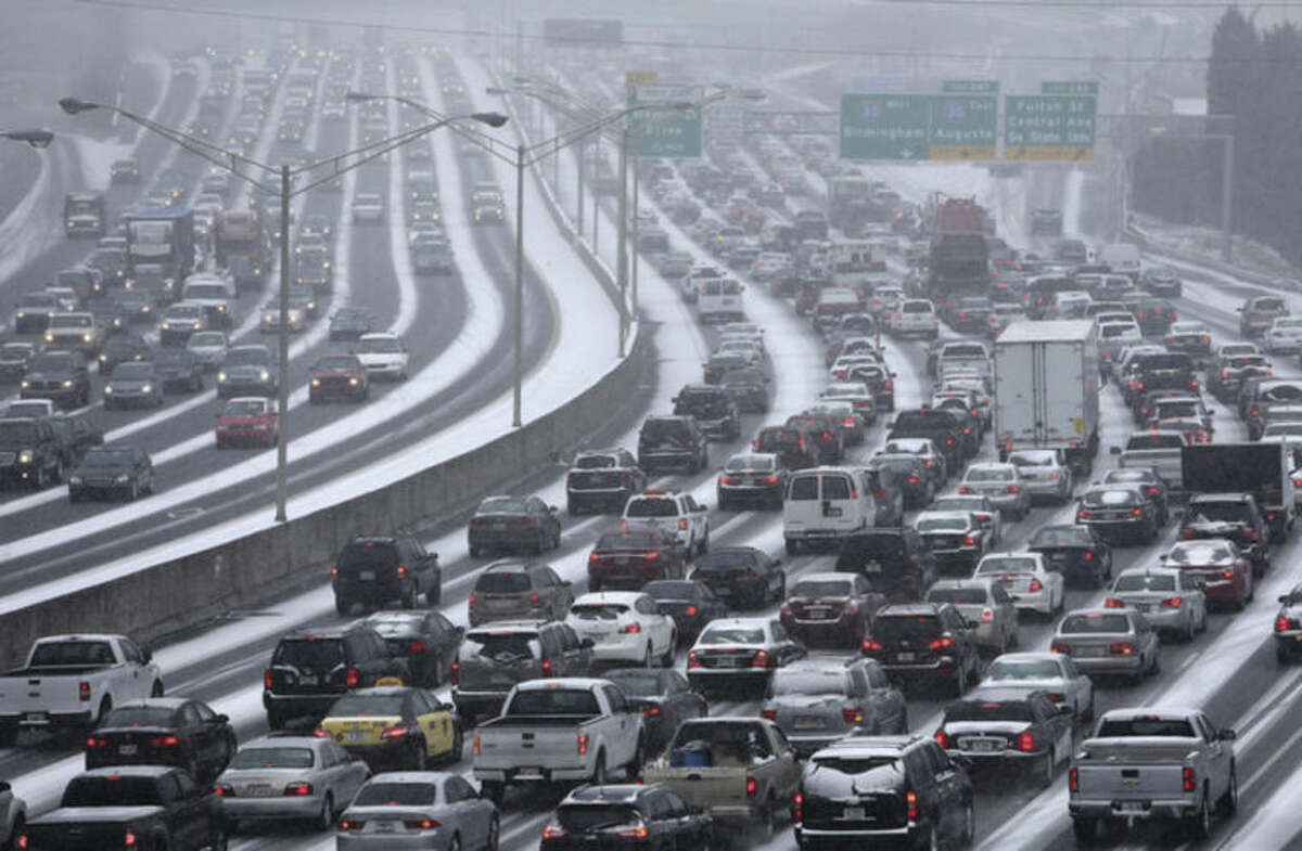 AP file photo / The Atlanta Journal-Constitution, Ben Gray Traffic inches along the connector of Interstate's 75 and 85 as snow blankets Metro Atlanta on Tuesday, Jan. 28, as seen from the Pryor Street overpass. Georgia Gov. Nathan Deal has already declared a state of emergency to be better prepared for another storm heading there Tuesday.