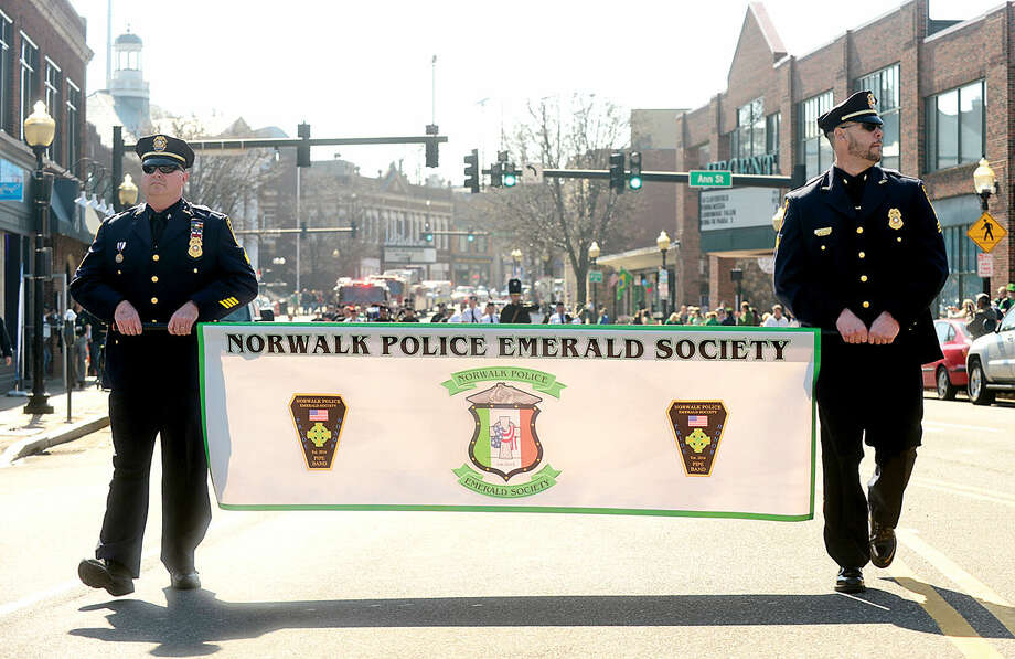 Hour photo / Erik Trautmann The Norwalk Police Emerald Society leads the first Norwalk St. Patrick's Day parade Thursday which made it's way down South and North Main Streets ending at O'Neill's Pub.