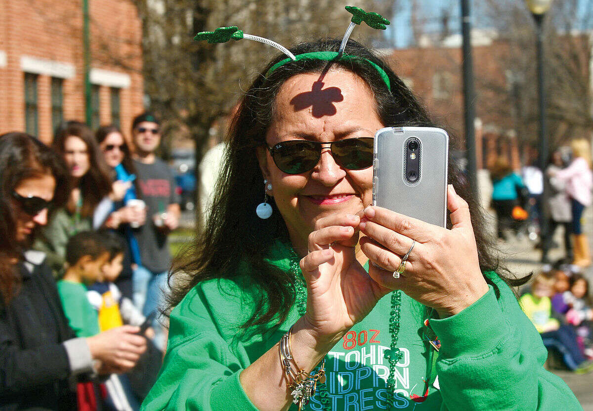 Hour photo / Erik Trautmann Norwalk residents cheer on the first Norwalk St. Patrick's Day parade Thursday which made it's way down South and North Main Streets ending at O'Neill's Pub.