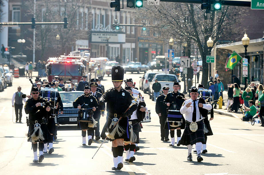Hour photo / Erik Trautmann The Norwalk Police Emerald Society Pipe Band leads the first Norwalk St. Patrick's Day parade Thursday which made it's way down South and North Main Streets ending at O'Neill's Pub.