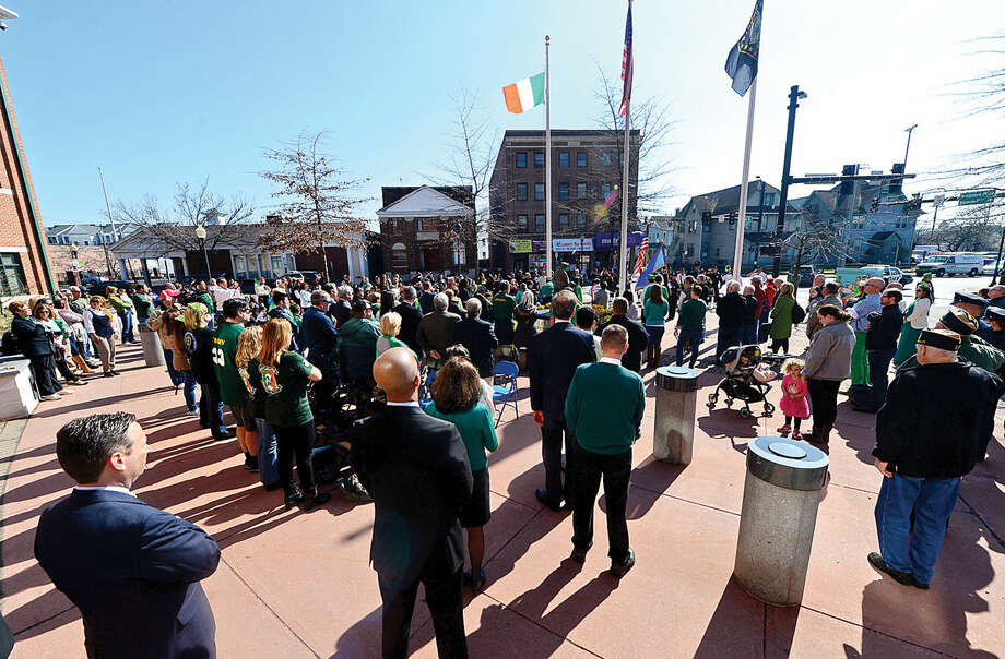 Hour photo / Erik Trautmann The Norwalk Police Department Emerald League held a ceremony in front of police headquarters before the first St. Patrick's Day parade Thursday.