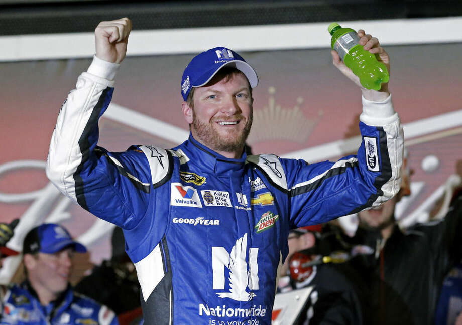 Dale Earnhardt Jr celebrates in Victory Lane after winning the first of two qualifying races for the Daytona 500 NASCAR Sprint Cup series auto race at Daytona International Speedway in Daytona Beach, Fla., Thursday, Feb. 19, 2015. (AP Photo/John Raoux)