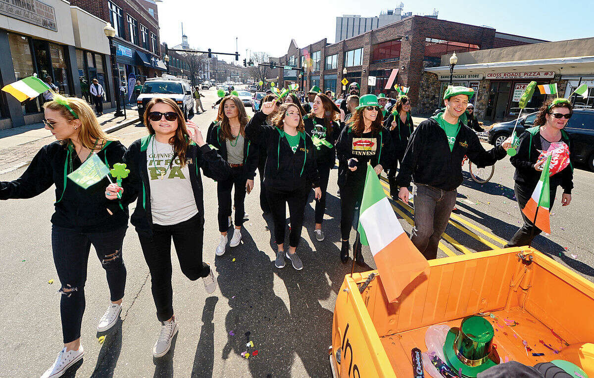 Hour photo / Erik Trautmann A group from Inspira marketing participates in the first Norwalk St. Patrick's Day parade Thursday which made it's way down South and North Main Streets ending at O'Neill's Pub.
