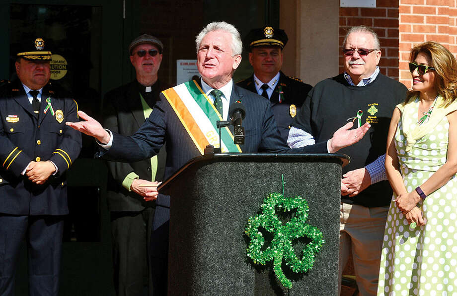 Hour photo / Erik Trautmann Norwalk mayor Harry Rilling greets the crowd as the Norwalk Police Department Emerald League held a ceremony in front of police headquarters before the first St. Patrick's Day parade Thursday.