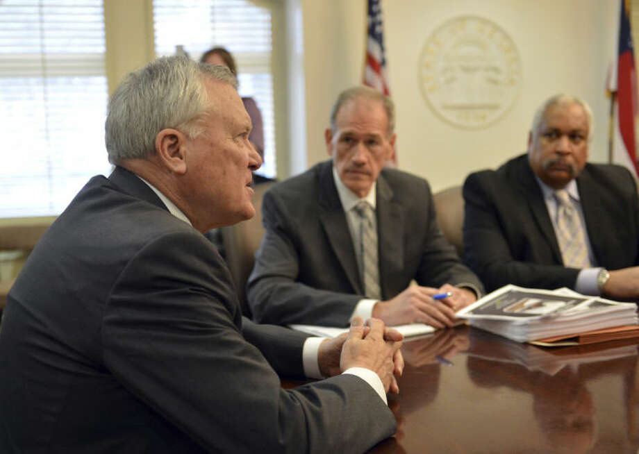 Gov. Nathan Deal meets with members of the Operations Command Monday Feb. 10, 2014. The governor issued a state of emergency Monday morning in advance of winter weather that is forecasted for the area. (AP Photo/Atlanta Journal-Constitution, Brant Sanderlin) MARIETTA DAILY OUT; GWINNETT DAILY POST OUT; LOCAL TV OUT; WXIA-TV OUT; WGCL-TV OUT
