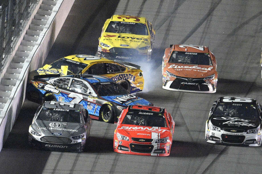 Sam Hornish Jr. (9) and Alex Bowman (7) hit the wall along the front stretch during the second of two qualifying races for the Daytona 500 NASCAR Sprint Cup series auto race at Daytona International Speedway, Thursday, Feb. 19, 2015, in Daytona Beach, Fla. (AP Photo/Phelan M. Ebenhack)