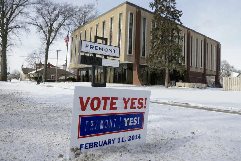 "In this Thursday, Feb. 6, 2014 photo, a yard sign urging voters to vote ""Yes"" is seen in front of City Hall in Fremont, Neb. Voters in the eastern Nebraska city of Fremont will decide in a special election on Tuesday, Feb. 11, whether to drop housing restrictions aimed at reducing illegal immigration they had approved in 2010. The city leaders scheduled the special election because of concerns the housing restrictions could cost them millions in federal grants and lead to more lawsuits against the city. (AP Photo/Nati Harnik)"