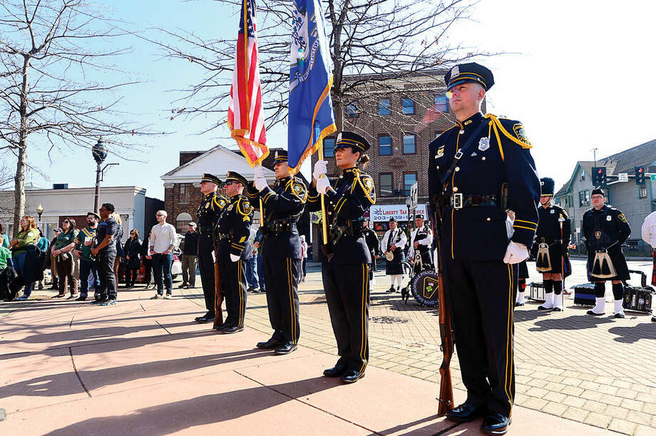 Hour photo / Erik Trautmann The Norwalk Police Department Honor Guard stand at attention during a ceremony in front of police headquarters before the first St. Patrick's Day parade Thursday.