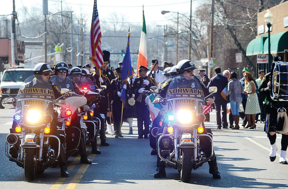 Hour photo / Erik Trautmann The Norwalk Police Depatment Motocycle contingent leads the first Norwalk St. Patrick's Day parade Thursday which made it's way down South and North Main Streets ending at O'Neill's Pub.