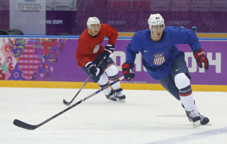 USA defenseman Ryan McDonagh, right, and forward Ryan Callahan run through a drill during a training session at the 2014 Winter Olympics, Monday, Feb. 10, 2014, in Sochi, Russia. (AP Photo/Julie Jacobson)