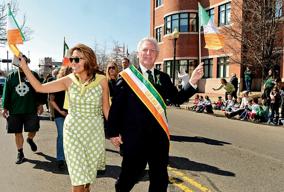 Hour photo / Erik Trautmann Norwalk mayor Harry Rilling, who was named Grand Marshal, and his wife Lucia march in the first Norwalk St. Patrick's Day parade Thursday which made it's way down South and North Main Streets ending at O'Neill's Pub.