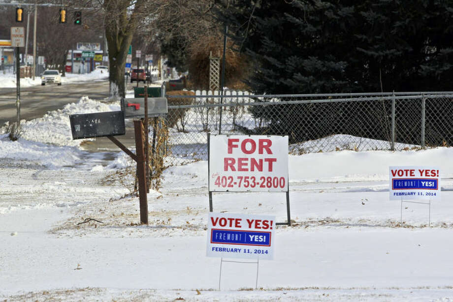 "In this Thursday, Feb. 6, 2014 photo, yard signs urging voters to vote ""Yes,"" stand in Fremont, Neb. Voters in the eastern Nebraska city of Fremont will decide in a special election on Tuesday, Feb. 11, whether to drop housing restrictions aimed at reducing illegal immigration they had approved in 2010. The city leaders scheduled the special election because of concerns the housing restrictions could cost them millions in federal grants and lead to more lawsuits against the city. (AP Photo/Nati Harnik)"