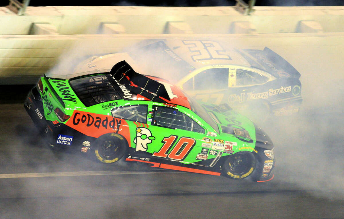 Danica Patrick (10) spins backward as she is hit by Bobby Labonte (32) during the second of two qualifying races for the Daytona 500 NASCAR Sprint Cup Series auto race at Daytona International Speedway, Thursday, Feb. 19, 2015, in Daytona Beach, Fla. (AP Photo/John Chilton)