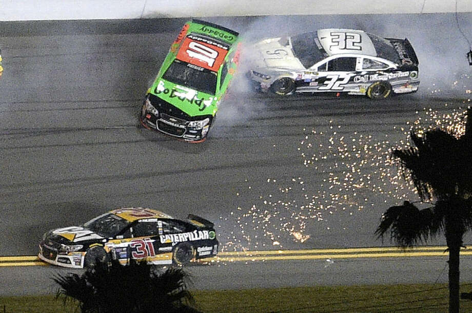 Danica Patrick (10) and Bobby Labonte (32) collide between Turns 3 and 4 as Ryan Newman (31) tries to avoid them during the second of two qualifying races for the Daytona 500 NASCAR Sprint Cup series auto race at Daytona International Speedway, Thursday, Feb. 19, 2015, in Daytona Beach, Fla. (AP Photo/Phelan M. Ebenhack)