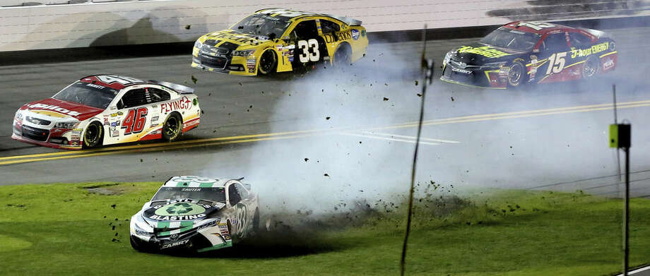 Johnny Sauter spins into the tri-oval during the first of the two qualifying races for the NASCÅR Sprint Cup series Daytona 500 auto race at Daytona International Speedway, Thursday, Feb. 19, 2015. (AP Photo/Orlando Sentinel, Joe Burbank)
