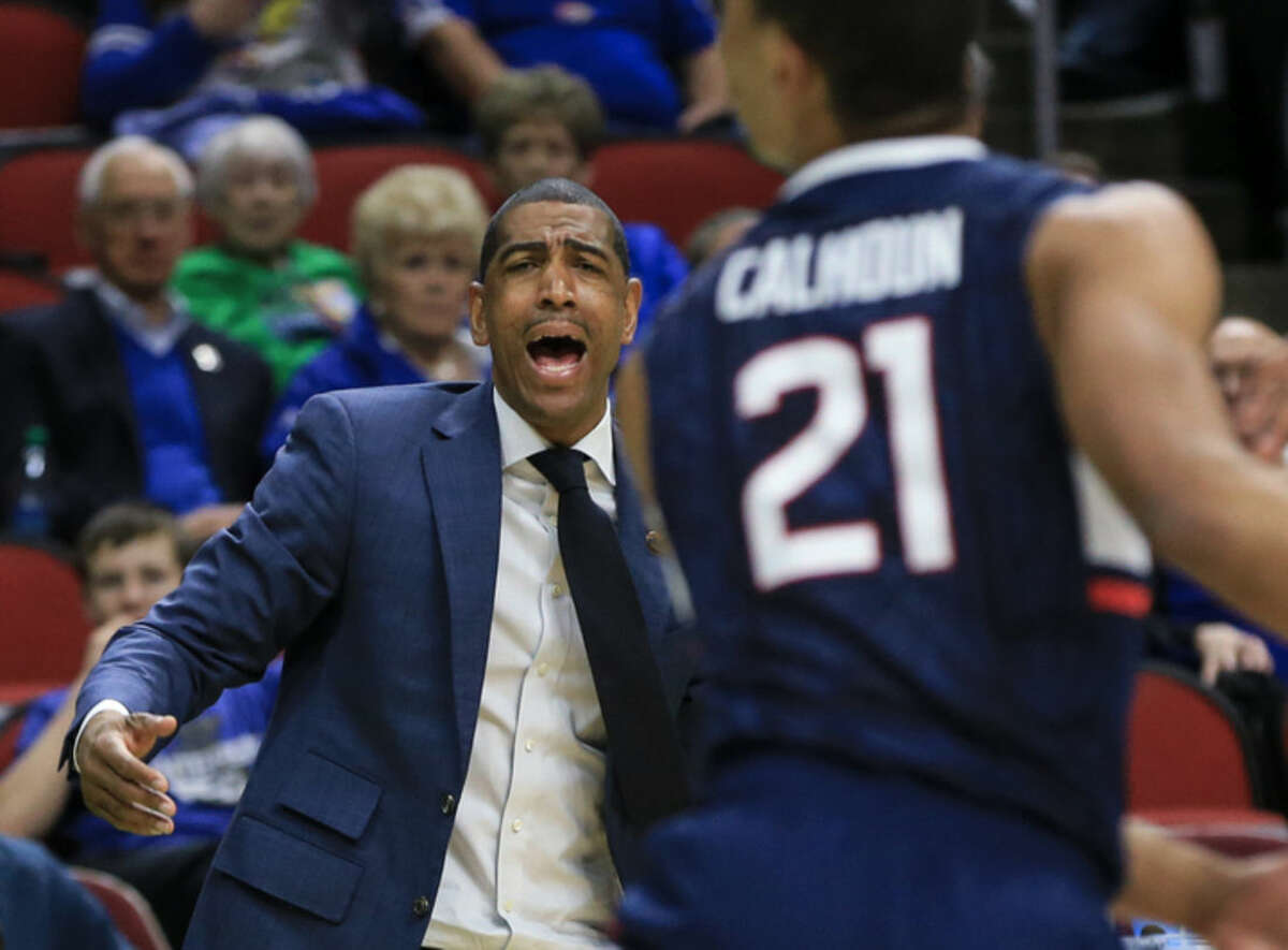Connecticut coach Kevin Ollie shouts instructions during a first-round men's college basketball game against Colorado in the NCAA Tournament in Des Moines, Iowa, Thursday, March 17, 2016. (AP Photo/Nati Harnik)