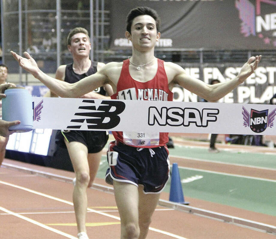 Hour photo/Mary Albl - Brien McMahon's Eric van der Els breaks the tape at the finish line to win the 2016 New Balance Indoor Track National championship in the 5,000-meter run on Friday at The Armory in New York City.