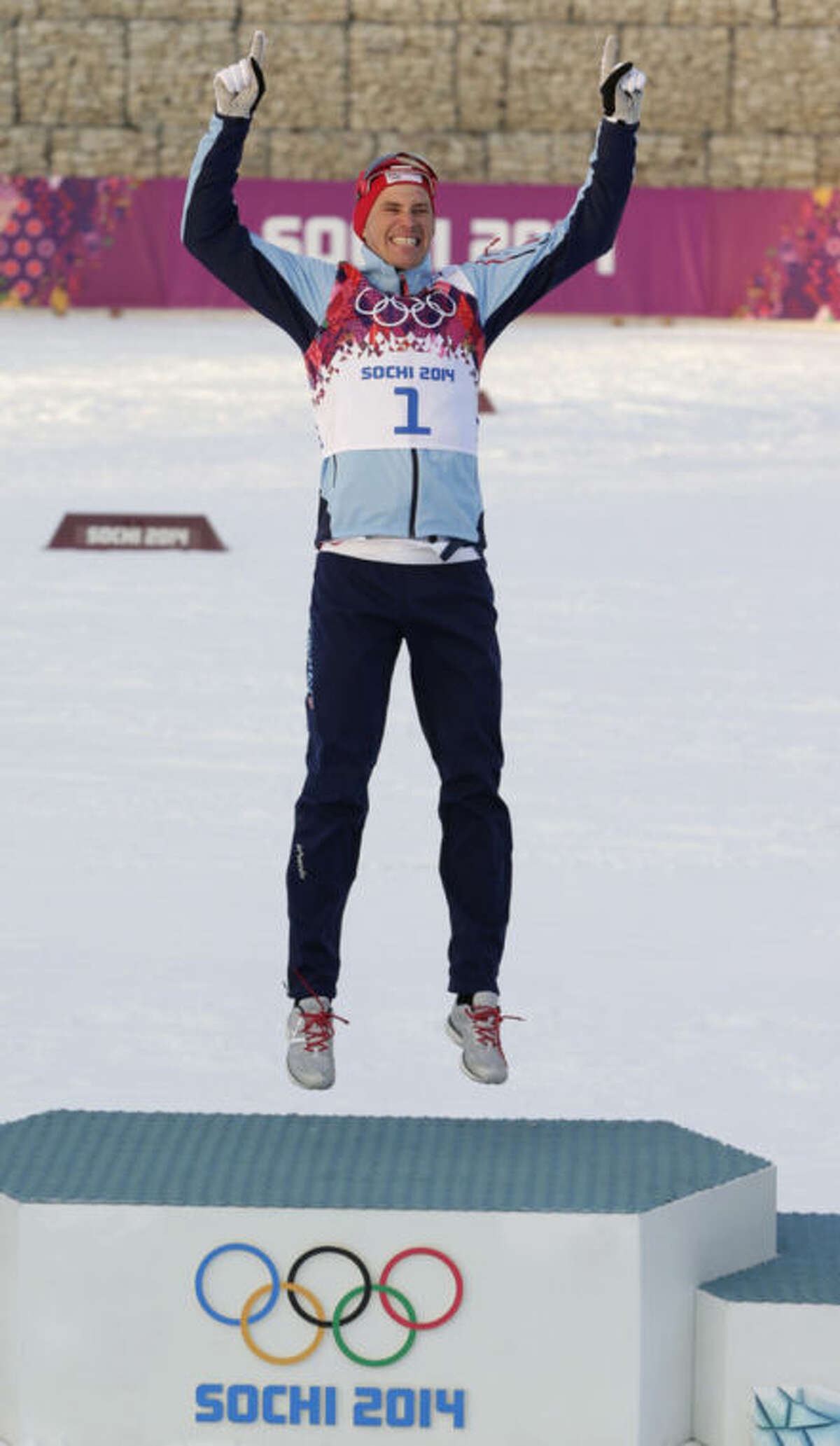 Norway's Ola Vigen Hattestad celebrates winning the gold medal during the flower ceremony for the men's cross-country sprint at the 2014 Winter Olympics, Tuesday, Feb. 11, 2014, in Krasnaya Polyana, Russia. (AP Photo/Matthias Schrader)