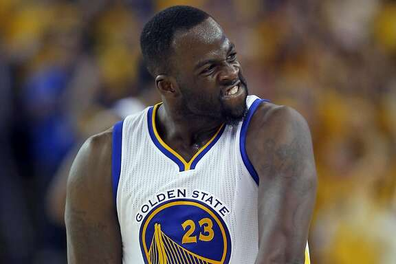 Golden State Warriors' Draymond Green reacts to his 3-pointer in 4th quarter of Warriors' 96-88 win over Oklahoma City Thunder in Game 7 of NBA Playoffs' Western Conference finals at Oracle Arena in Oakland, Calif., on Monday, May 30, 2016.