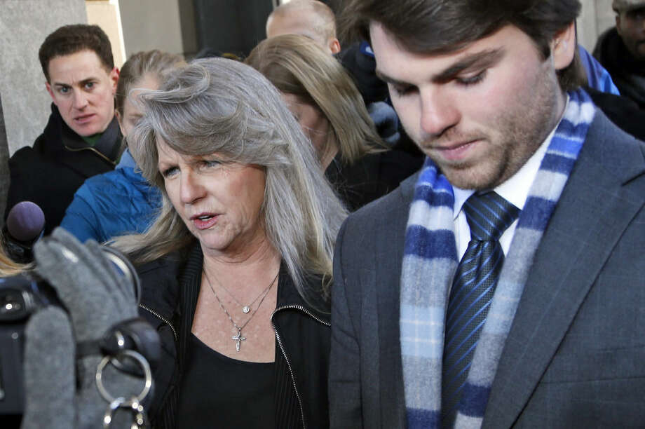 Former first lady Maureen McDonnell leaves federal court with her son Bobby after being sentenced to one year and one day on corruption charges in Richmond, Va., Friday, Feb. 20, 2015. Fighting back tears, McDonnell apologized to her family and Virginians and said she takes full responsibility. (AP Photo/Steve Helber)