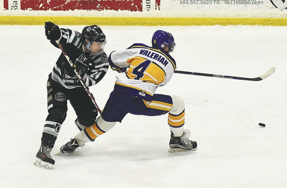 Hour photo/John NashConnecticut Oilers skater Alex Wilkinson, left, finds himself on the wrong side of New Hampshire Junior Monarchs player CJ Valerian during their EHL semifinal series at the Tri-Town Arena in Hooksett, N.H. The Monarchs won Sunday's second game 5-1 to sweep the best of three series 2-0.