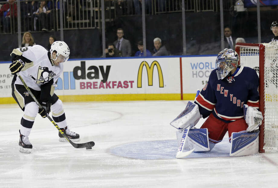 Pittsburgh Penguins left wing Conor Sheary (43) looks to take a shot on New York Rangers goalie Henrik Lundqvist (30) in the first period of an NHL hockey game, Sunday, March 13, 2016, in New York. (AP Photo/Adam Hunger)